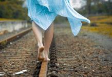 girl_walking_on_railway_track
