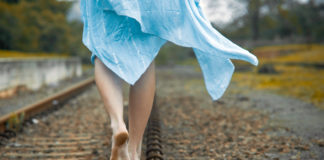 girl_walking_on_railway_track
