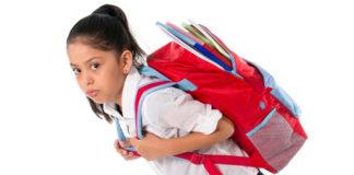 child_wearing_heavy_school_bag