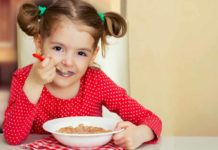 child_having_breakfast_caregrow